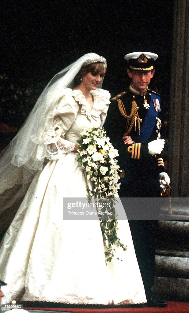The Prince and Princess of Wales leave St Paul's Cathedral after their wedding, 29th July 1981. She wears a wedding dress by David and Elizabeth Emmanuel and the Spencer family tiara.