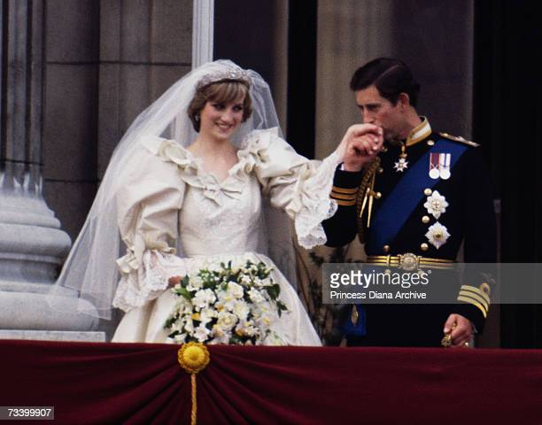 The Prince and Princess of Wales on the balcony of Buckingham Palace on their wedding day 29th July 1981 She wears a wedding dress by David and...