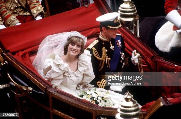 The Prince and Princess of Wales return to Buckingham Palace by carriage after their wedding 29th July 1981 She wears a wedding dress by David and...