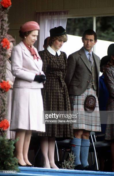 The Prince and Princess of Wales stand with the Queen at the Braemar Highland Games in Scotland September 1982 The Princess wears a tartan Caroline...