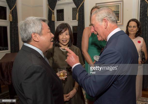 The Prince chats to Parry Oli Chief Hydrographer Maritime and Port Authority as Their Royal Highnesses The Prince of Wales and The Duchess of...