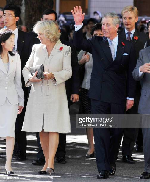 The Prince of Wales accompanied by the Duchess of Cornwall after they arrived at the Keio University in central Tokyo this morning