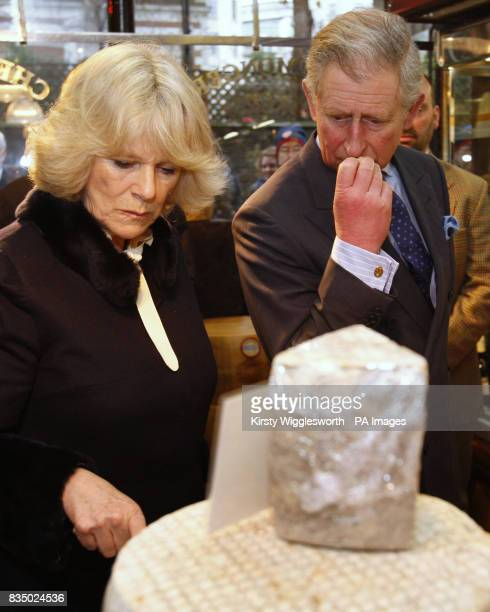 The Prince of Wales accompanied by the Duchess of Cornwall during a visit to cheese seller Paxton and Whitfield in central London