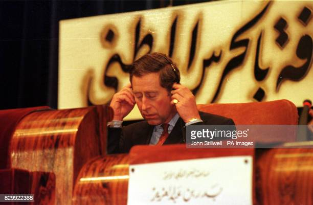 The Prince of Wales adjusts his headset to listne to a translation during a visit to Saudi Arabia