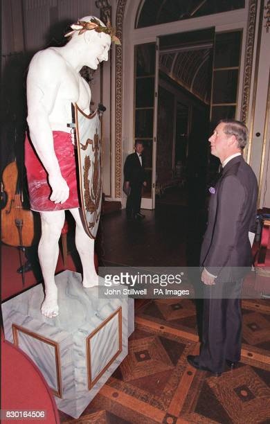 The Prince of Wales admires a 'living statue' on show at a Buckingham Palace charity gala in aid of the Kirov Ballet and the Philharmonia Orchestra...