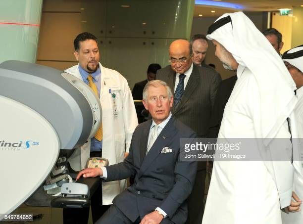 The Prince of Wales after he used hand controllers and a 3D microscope to perform micro robotic Heart surgery watched by Professor Abdullah Al Ansari...