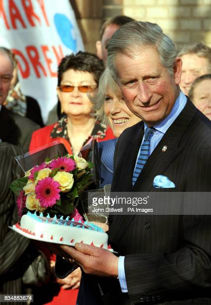The Prince of Wales after he was presented with a birthday cake from staff at a national newspaper during a visit to a Prince's Trust project at...
