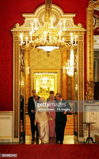 The Prince of Wales and Britain's Queen Elizabeth II lead other royal family members at Buckingham Palace in London as they arrive to attend a...