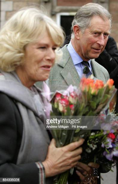 The Prince of Wales and Duchess of Cornwall at the old railway station in Ballater Royal Deeside where a reproduction Victorian railway carriage has...