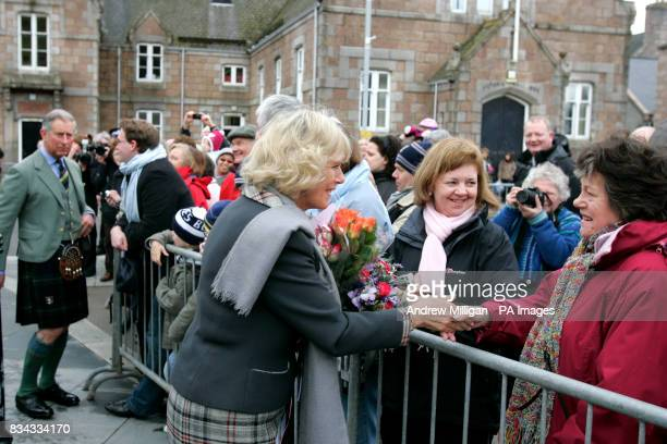 The Prince of Wales and Duchess of Cornwall meeting with the public outside the old railway station in Ballater Royal Deeside