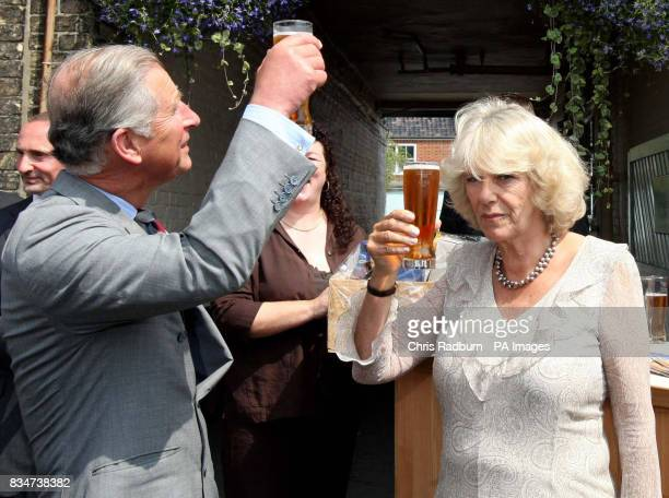 The Prince of Wales and Duchess of Cornwall pictured sampling the UK's first carbon neutral beer during a visit to an upmarket seaside resort