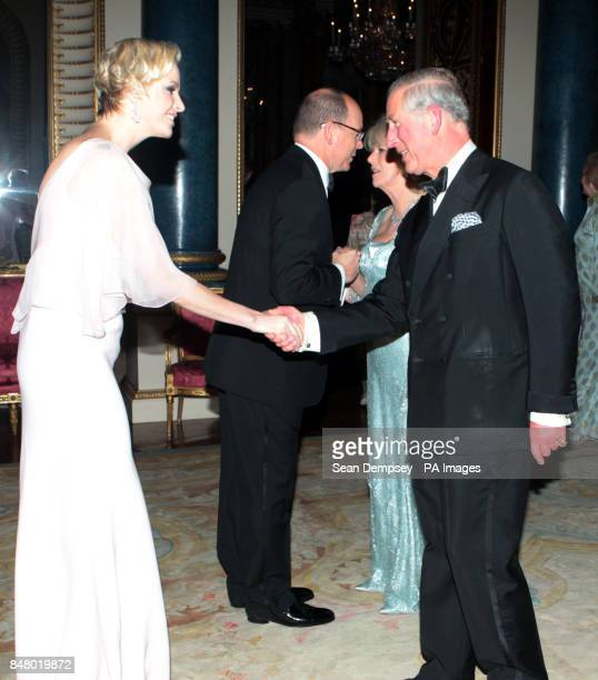 The Prince of Wales and the Duchess of Cornwall greet Prince Albert II and Princess Charlene of Monaco as they arrive for a dinner at Buckingham...