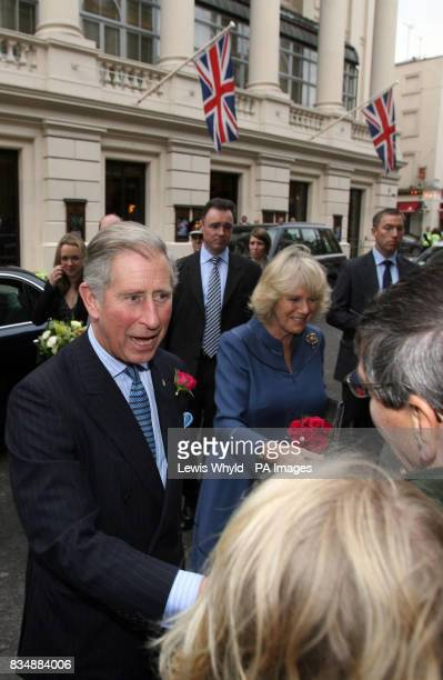 The Prince of Wales and the Duchess of Cornwall greet the public after leaving the Royal Opera House in London