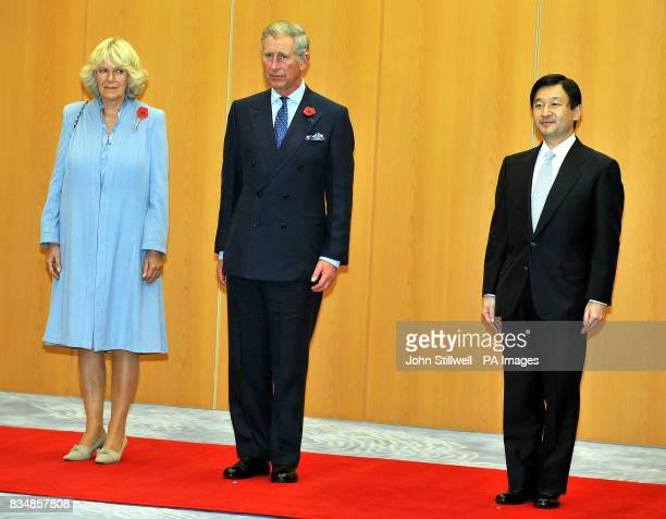 The Prince of Wales and the Duchess of Cornwall stand with Crown Prince Naruhito of Japan for the National anthems after they arrived at Haneda...