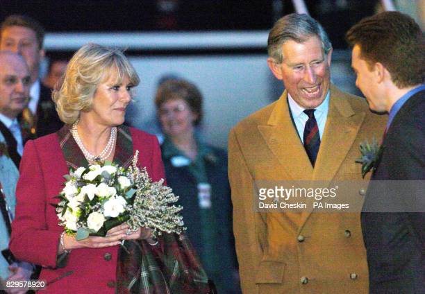 The Prince of Wales and the Duchess of Cornwall talk to Andy Flower the managing director of Aberdeen airport on their arrival as they make their way...