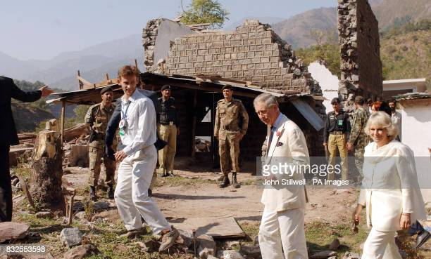 The Prince of Wales and the Duchess of Cornwall tour the shattered ruins of houses in the Pakistan town of Pattika which was hit by an Earthquake...
