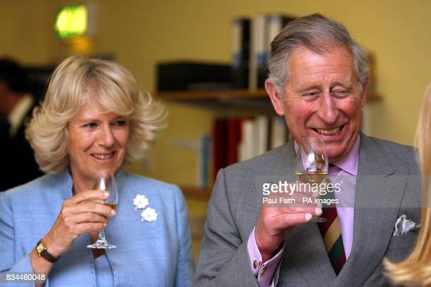 The Prince of Wales and the Duchess of Cornwall try some Bushmills whiskey on a visit to the Distillery in Co Antrim Northern Ireland