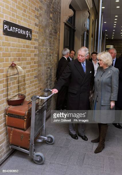 The prince of Wales and the Duchess of Cornwall try to board the Harry Potter inspired Hogwarts Express at the fictional Platform of 9 and three...