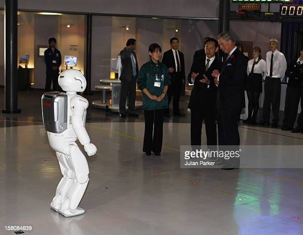 The Prince Of Wales And The Duchess Of Cornwall Watch A Asimo Robot Display At The Miraikan Museum In Tokyo On The First Day Of Their Tour Of Japan
