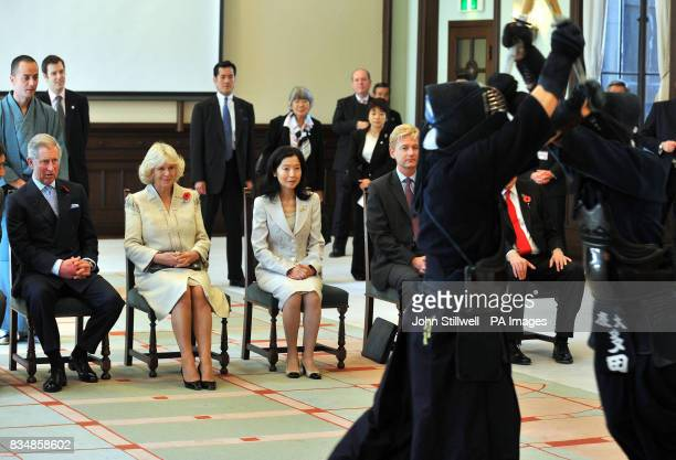 The Prince of Wales and the Duchess of Cornwall watch a Kendo sword demonstration using practice Bamboo sticks at the Keio University in central...