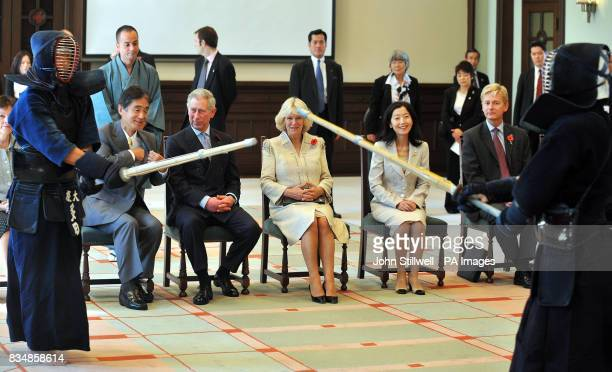 The Prince of Wales and the Duchess of Cornwall watch a Kendo sword demonstration at the Keio University in central Tokyo this morning