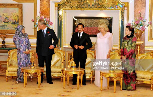 The Prince of Wales and the Duchess of Cornwall with the Sultan of Brunei Hassanal Bolkiah Mu'izzaddin Waddaulah and his two wives at a reception...