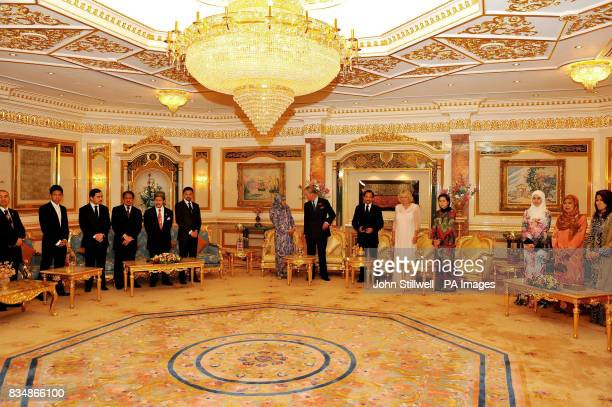 The Prince of Wales and the Duchess of Cornwall with the Sultan of Brunei Hassanal Bolkiah Mu'izzaddin Waddaulah his two wives and guests at a...
