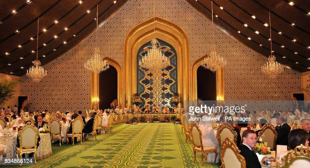 The Prince of Wales and the Duchess of Cornwall with the Sultan of Brunei and his two wives as they sit down for dinner at the Royal Palace in Bandar...