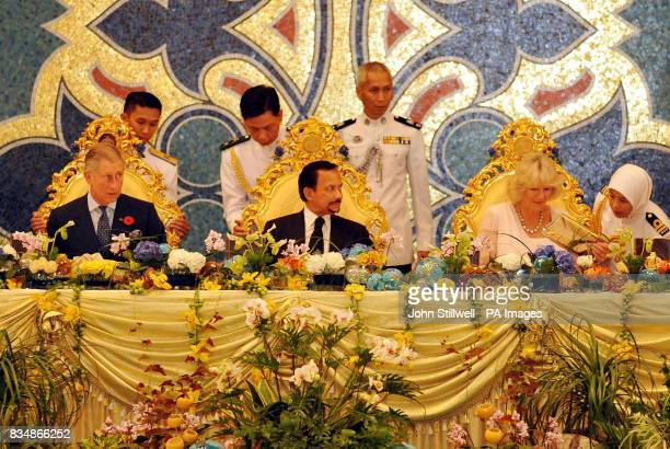 The Prince of Wales and the Duchess of Cornwall with the Sultan of Brunei as they sit down for dinner at the Royal Palace in Bandar Seri Begawan...