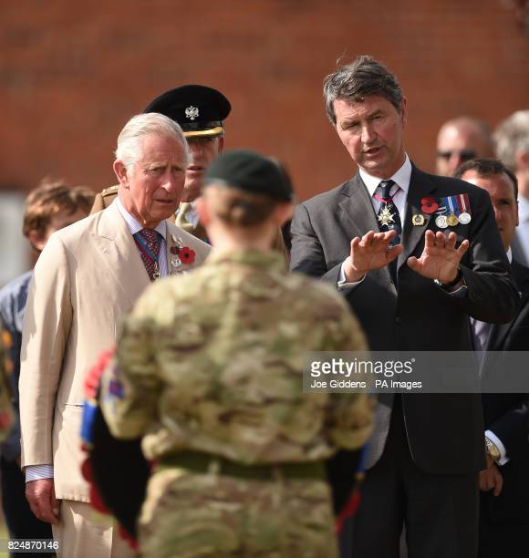 The Prince of Wales and Vice Admiral Sir Timothy Laurence during a wreath laying ceremony at the Artillery Wood Cemetery in Ypres Belgium to mark the...