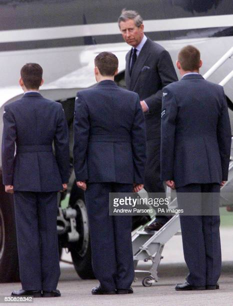 The Prince of Wales arrives at RAF Northolt northwest London after returning from Switzerland where he and his sons cut short their skiing holiday...