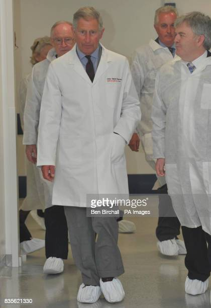 The Prince of Wales arrives in the dispensing area at the OrthoClinical Diagnostics Plant at Pencoed Mid Glamorgan Wales dressed in his white...