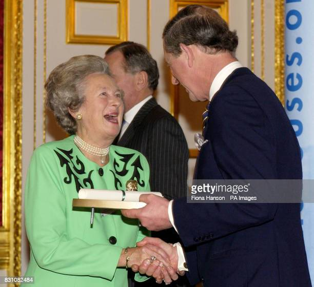 The Prince of Wales as Patron of the Almshouse Association presents a Patron's Award to Lady Benson Chair of Salisbury City Almshouse and Welfare...