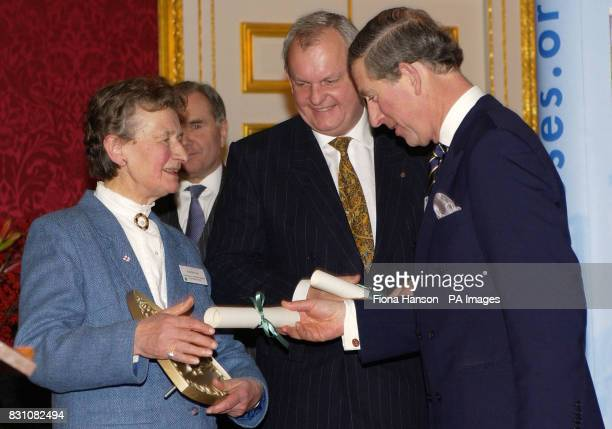 The Prince of Wales as Patron of the Almshouse Association presents Patron's Awards to Hazel McCabe Chair of St John's Hospital Canterbury Kent and...