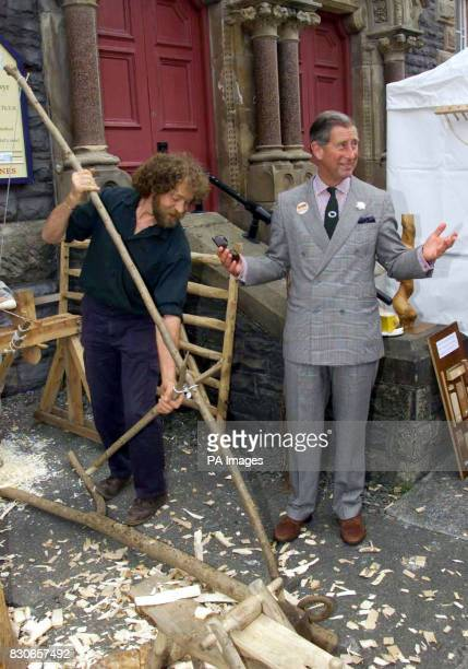 The Prince of Wales assists with a repair to a broken pull lathe during a visit to Aberystwyth Farmers' Market Wales The Prince met stallholders...