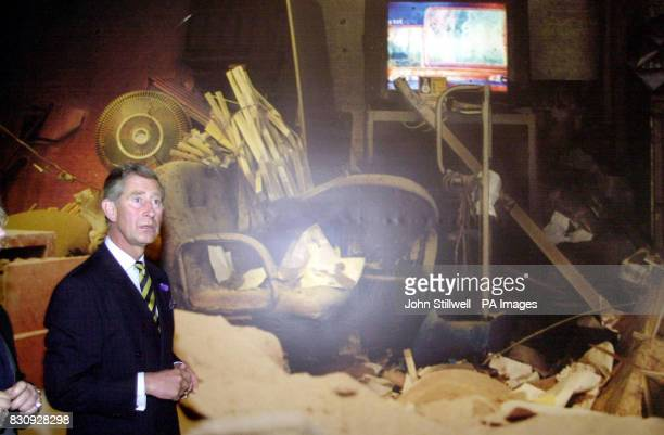 The Prince of Wales at the old Wapping power station east London standing in front of a giant size photograph of an apartment block damaged during...
