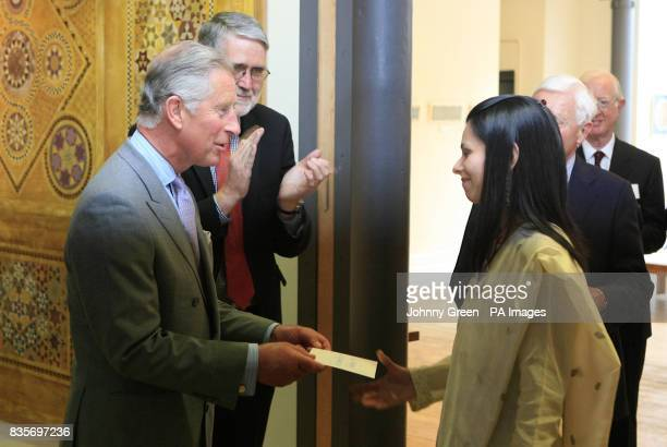 The Prince of Wales awards Sara Salman from Lahore in Pakistan the Jerwood Prize for Traditional Arts as he meets post graduate students at the...