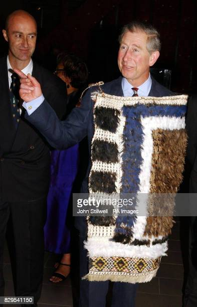 The Prince of Wales beams with delight as he wears a Maori Korowai cloak during his tour of the Auckland War Museum in New Zealand to see the...