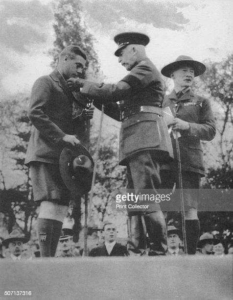 The Prince of Wales being invested with the Silver Wolf by the Duke of Connaught London 1922 The Prince receiving the award at the Scout rally at...