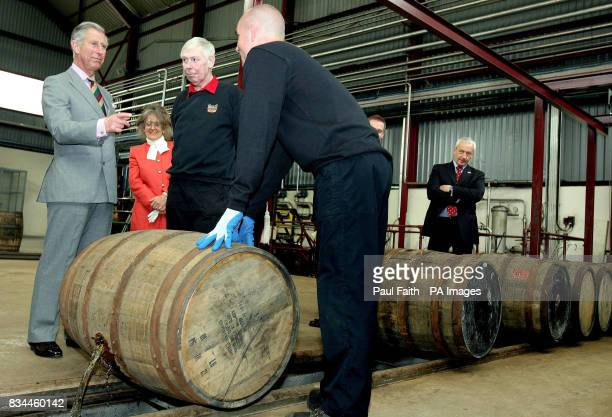 The Prince of Wales chats to workers whilst on a visit to the Bushmills whiskey Distillery in Co Antrim Northern Ireland