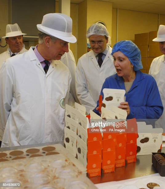 The Prince of Wales chats with staff packing Duchy Original biscuits at the Dorchester Chocolate Factory in Poundbury Dorset