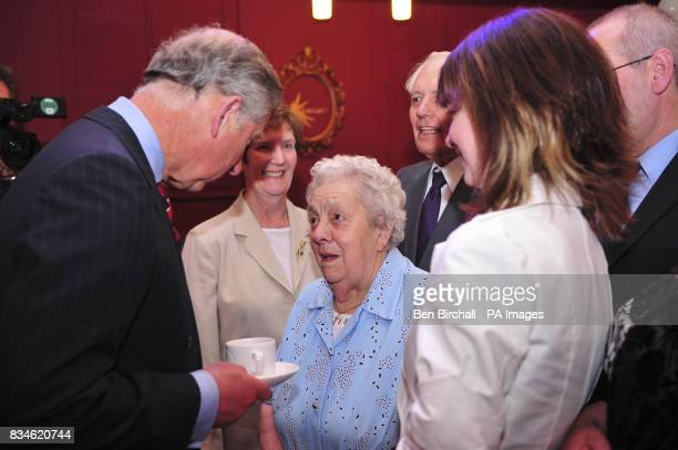 The Prince of Wales chats with Winnie Davies who will be aged 99 on July 27 and is a lifelong resident of Pentref Village and a regular churchgoer...