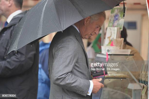 The Prince of Wales choosing a small box of chocolates from a stall holder at the National Botanic Gardens of Wales in Carmarthen as he continues his...