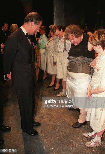 The Prince of Wales discovers the secrets concealed beneath the skirts of the Witch from 'Hansel and Gretel' played by Nigel Robson when the Prince...