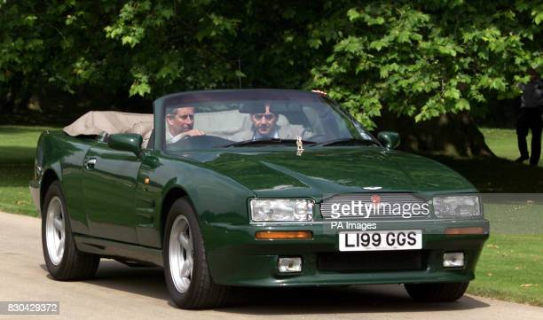 The Prince of Wales drives his Aston Martin Virage Volante 63Litre Convertible to the opening of The Organic Kitchen Garden in Saffron Walden Prince...
