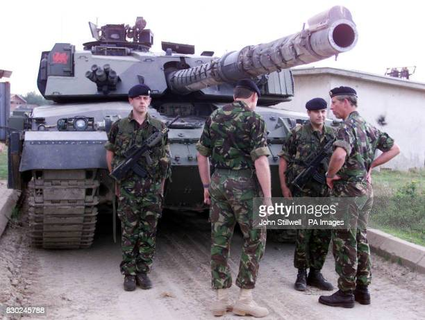 The Prince of Wales during his oneday visit to the outskirts Pristina inspected a Challenger tank of the 1st Queen's Dragoon Guards with Regimental...