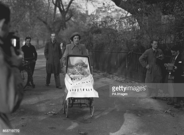 The Prince of Wales during his second birthday outing in St James's Park London with nanny Mabel Anderson