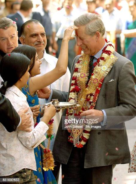 The Prince of Wales enjoys a traditional greeting from wellwishers while touring the old city of Jaipur Friday March 31 2006 Charles's twoweek...