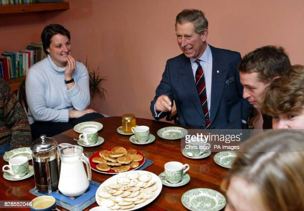 The Prince of Wales enjoys tea and biscuits during his visit to Pant farm in Llanvetherine near Abergavennywith Gary Yeomans and Jessica Rumsey who...