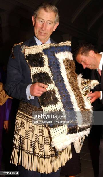 The Prince of Wales enjoys wearing a Maori Piu Piu skirt under his Korowai cloak during his tour of the Auckland War Museum